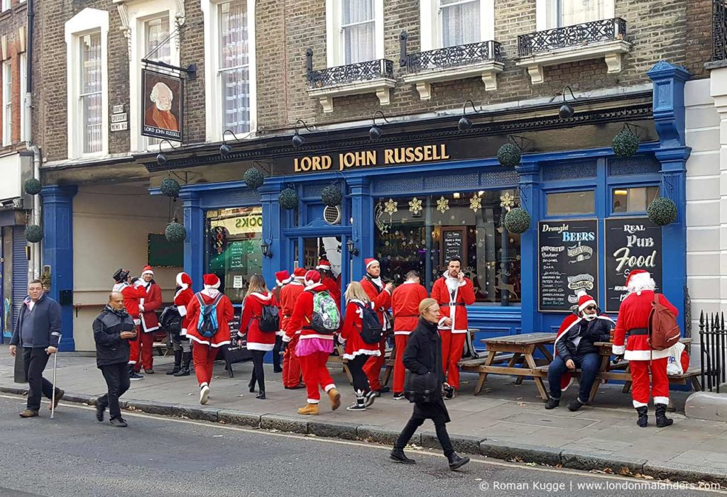 Weihnachten Tradition London England Santa Con und Run